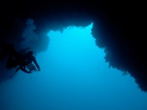 Passing through the arch of the Blue Hole of Dahab.